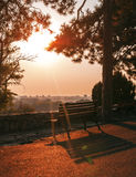 Colorful sunset scenery on castle path with a bench background Stock Image