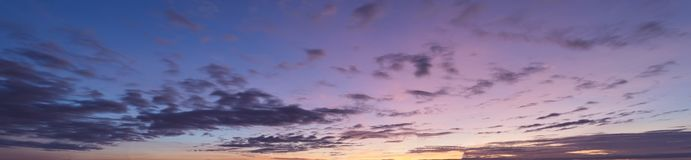 Colorful sunset sky with clouds in twilight time stock photo