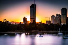 Colorful sunset sky in modern city stock photography