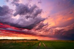 Free Colorful Sunset Sky Over A Dirt Road And Field Stock Image - 200324231