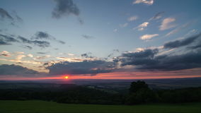 Colorful sunset sky over countryside time lapse panoramic. Timelapse video of evening sunset sky with colorful clouds over countryside. Panoramic shot stock video footage