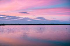 Sunset sky reflected in a lake, California royalty free stock image