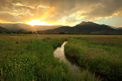 Colorful sunset sunbeams above a stream in Heber Valley. Sunset rays above a stream in rural Utah, USA Stock Photos