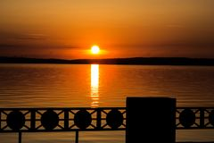 Colorful sunset or sunrise on the lake promenade stock photo