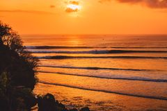 Colorful sunset or sunrise with ocean and big waves fo surfing. Colorful sunset or sunrise with ocean and big waves stock photos