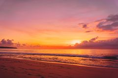 Colorful sunset or sunrise at tropical beach with ocean in Bali. Colorful sunset or sunrise at tropical beach with ocean stock image