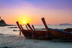 Colorful sunset with Thai traditional longtail boat on the beach Stock Photography