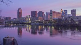 A medium wide long exposure shot of downtown Minneapolis and the Hennepin Avenue Bridge Reflecting in the Mighty Mississippi River stock footage