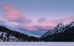 Colorful sunset at Twi Jack Lake, winter time, Banff National Park, Travel Alberta, Canada, Canadian Rockies, Rocky Mountains stock images
