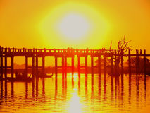 Colorful sunset at U Bein Bridge, Amarapura, Myanmar Royalty Free Stock Images