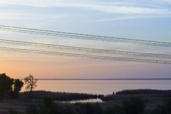 Colorful sunset wires for electric power transmission stock photo