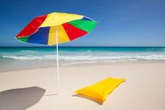 Colorful sunshade and air mattress Royalty Free Stock Photo