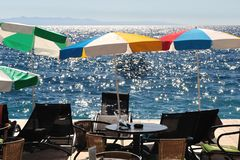 Sunshades and chairs on the beach with sea Royalty Free Stock Photos