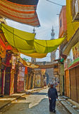 The colorful sunshades. CAIRO, EGYPT - OCTOBER 12, 2014: The merchants of Al-Muizz street market use colorful cloth to make the sunshades over the stalls, on Stock Photo