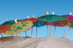 Colorful Sunshades on Sand stock photography
