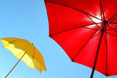 Colorful sunshades on a sunny summer day. Colorful sunshades umbrellas on a sunny summer day Stock Images