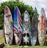 Colorful surf boards lined up in the streets of Maui, Hawaii. PAIA, HI -30 MARCH 2015: Colorful surfboards are lined up in the streets of Maui. Hawaii is the Royalty Free Stock Photo