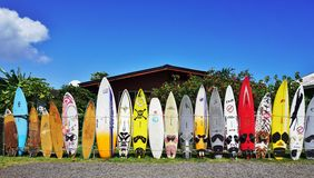 Colorful surf boards lined up in the streets of Maui, Hawaii. PAIA, HI -30 MARCH 2015: Colorful surfboards are lined up in the streets of Maui. Hawaii is the Stock Photo