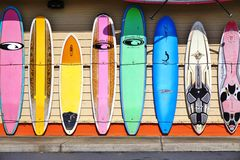 Colorful surf boards lined up in the streets of Maui, Hawaii. PAIA, HI -30 MARCH 2015: Colorful surfboards are lined up in the streets of Maui. Hawaii is the Royalty Free Stock Image
