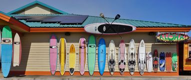 Colorful surf boards lined up in the streets of Maui, Hawaii. PAIA, HI -30 MARCH 2015: Colorful surfboards are lined up in the streets of Maui. Hawaii is the Stock Image