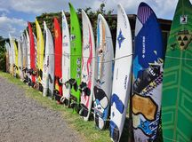 Colorful surf boards lined up in the streets of Maui, Hawaii. PAIA, HI -30 MARCH 2015: Colorful surfboards are lined up in the streets of Maui. Hawaii is the Royalty Free Stock Photography