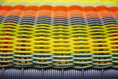 The colorful surface of a chair weaved with plastic canes Royalty Free Stock Photo