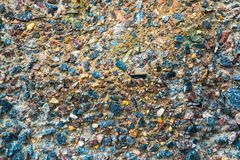Colorful surface of collapsing, corrosive concrete wall.Texture, old plate background.  royalty free stock image