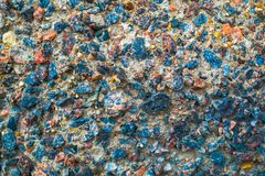 Colorful surface of collapsing, corrosive concrete wall.Texture, old plate background.  royalty free stock photo