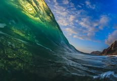 Colorful Surfing Wave Lit with sunlight in Pacific Ocean in Maui Stock Photos