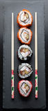 Colorful sushi with chopsticks Royalty Free Stock Photography