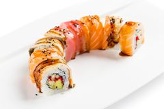 Colorful sushi roll with salmon, eel, tuna, avocado, cucumber, c Royalty Free Stock Photos