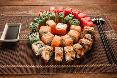 Colorful sushi rolls uramaki set closeup. Food art Royalty Free Stock Photos