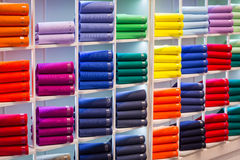 Colorful sweaters on the shop shelves Royalty Free Stock Photo