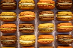 Colorful french macarons background close up. stock photo