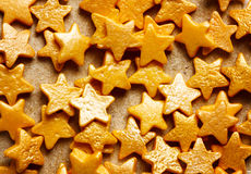 Colorful sweet background with gold star sprinkles Royalty Free Stock Photos