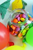 Colorful sweet candy. Pink, yellow and green candies and colorful ballon Royalty Free Stock Image