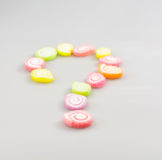 Colorful sweet fruit jelly candy and question mark Stock Photo