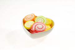 Colorful sweet fruit jelly candy on white dish Stock Photography