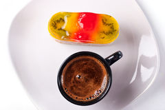 Colorful sweet jelly cake and coffe cup top Royalty Free Stock Photo