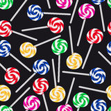 Colorful sweet lollipops seamless dark pattern Royalty Free Stock Images
