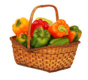 Colorful sweet peppers  in basket. Isolated on white landscape Stock Photo
