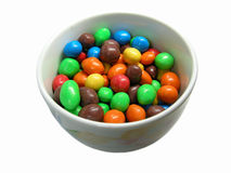 Colorful sweets. A bowl full of colorful round Easter chocolate egg sweets isolated on white background Royalty Free Stock Photo