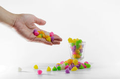 Colorful sweets are being picked Royalty Free Stock Photos