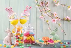 Colorful sweets. On a green wooden background Royalty Free Stock Images