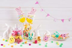 Colorful sweets. On a white wooden background Stock Photography