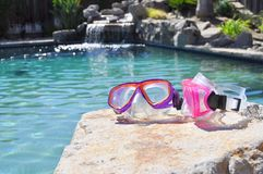 Colorful swim goggles. Pink and purple swim goggles Royalty Free Stock Photos
