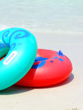 Colorful swimming rings Stock Photos