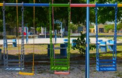 Colorful swing chairs playground children Royalty Free Stock Image