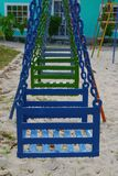 Colorful swing chairs playground children Royalty Free Stock Images