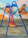 Colorful swing at the playground. In Lviv Stock Photo
